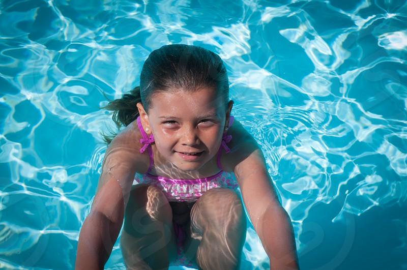 Day at the pool pool girl swimming water ripple tan photo