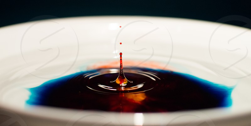 red black and brown liquid ripple photo