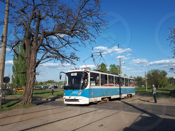 Blue tramway at the street photo