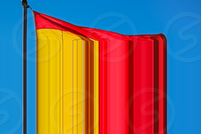 spain flag on blue sky photo