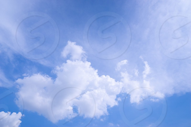 white fluffy cloud float on blue sky with copy space photo