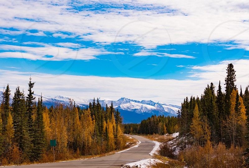 First snow in late fall or early winter at northern section of scenic route of Stewart-Cassair-Highway 37 in Northern British Coumbia mountain landscape BC Canada photo