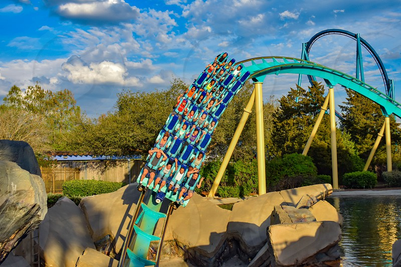 Orlando Florida. March 05 2019. People having fun Kraken rollercoaster at Seaworld Marine Theme Park (10) photo