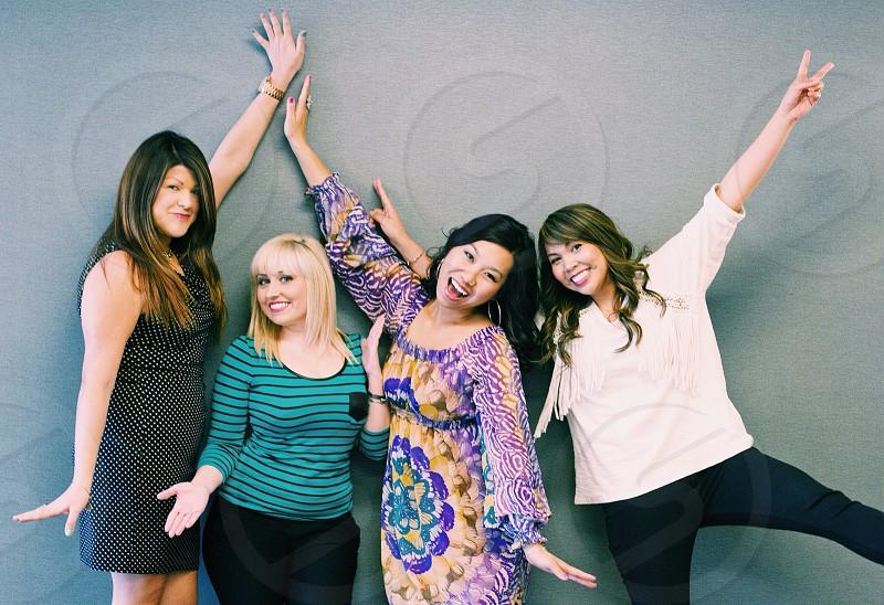 4 women posing photo