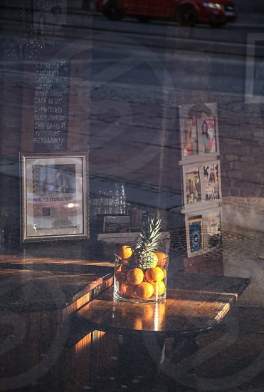 Mirrors and reflections cafe street fruits car city sunshine  photo