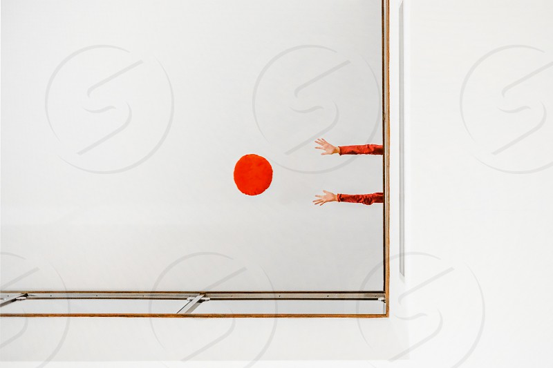 girls throwing a red ball down photo