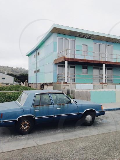 blue sedan on the road photo