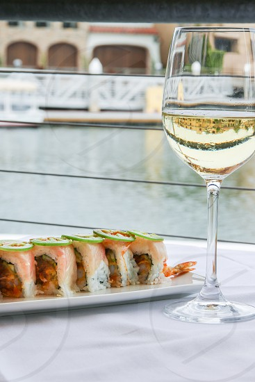 Sushi roll white wine and bay photo