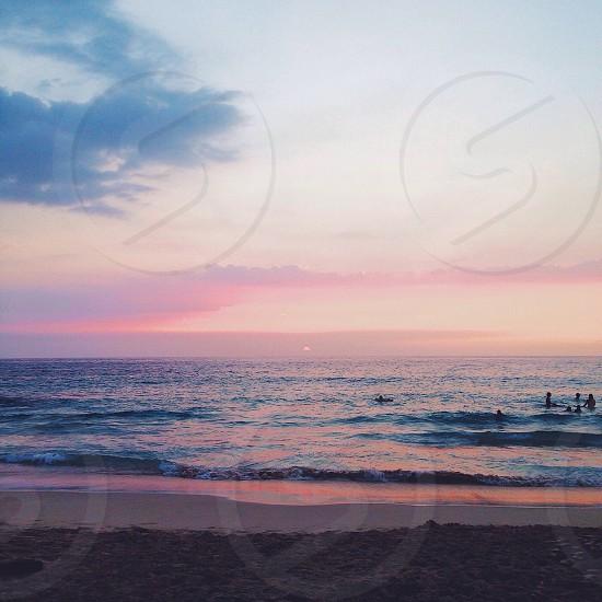 Sunset swim at Magic Sands Beach Big Island Hawaii. photo