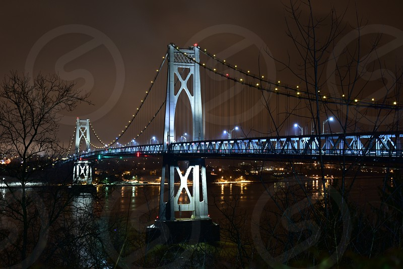 bridge lit during nighttime architectural photography photo