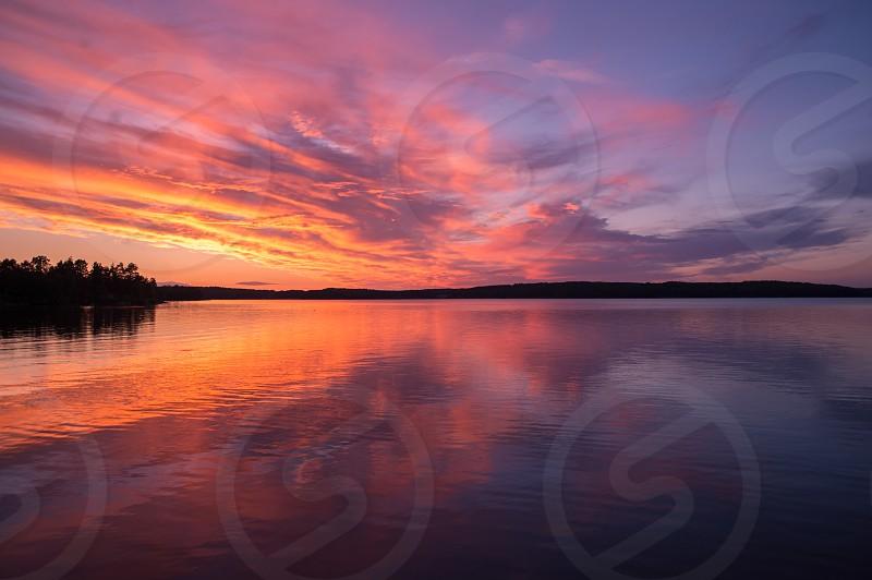 Sunset lake Sweden photo