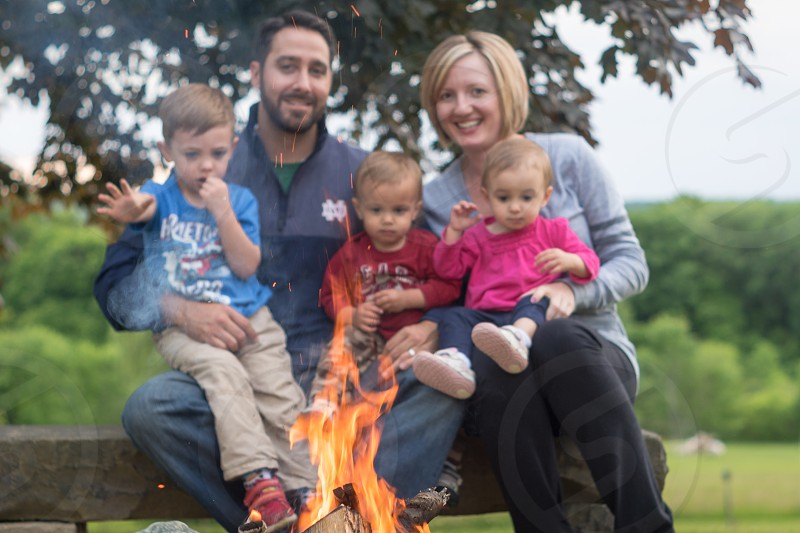 Father's Day 2016 keywords: Family Father Mother Kids Children Siblings Fire Outside Nature Outdoors Dad Mom Son Daughter Girl Boy. photo