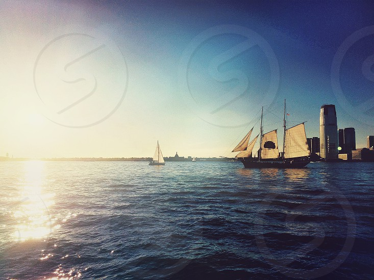 Sail river sailer sailer boat faded light photo