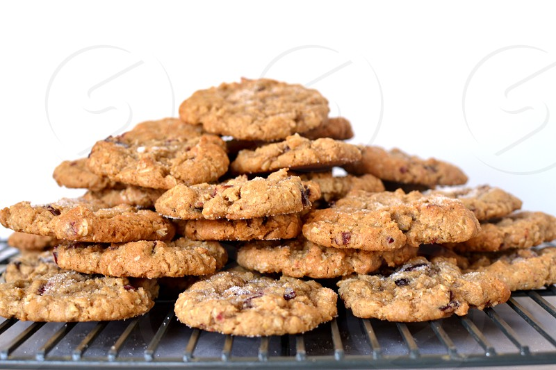 homemade oatmeal cookies piled on cooling rack photo