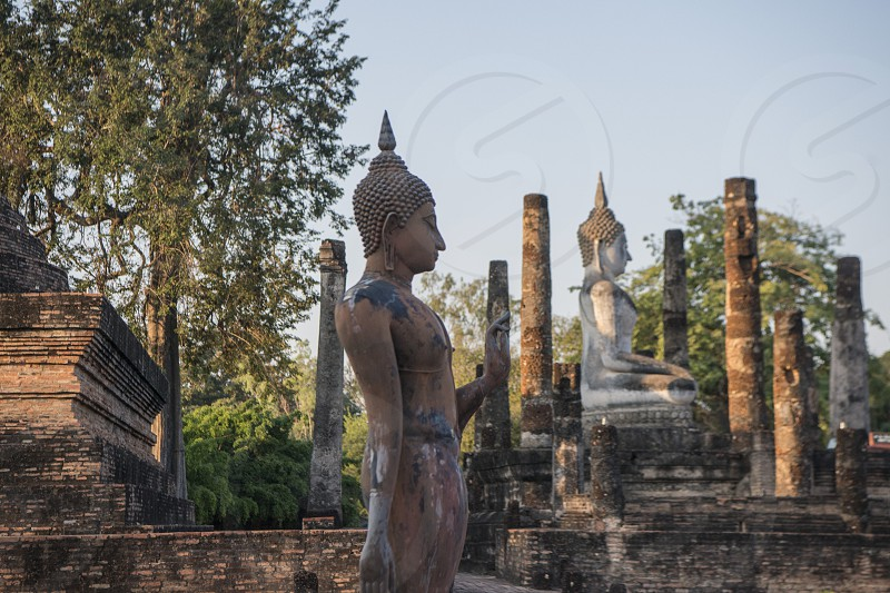 a Buddha with a stupa at the Wat Sa Si Temple at the Historical Park in Sukhothai in the Provinz Sukhothai in Thailand.   Thailand Sukhothai November 2018 photo
