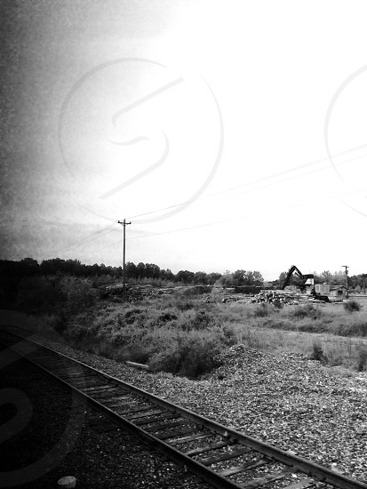 railway beside desert field photo