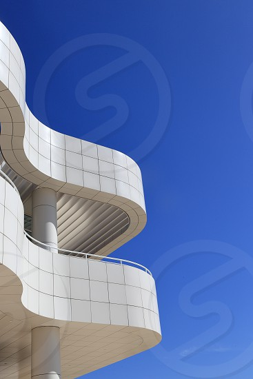 beige and gray scallop edge concrete structures under blue sky photo