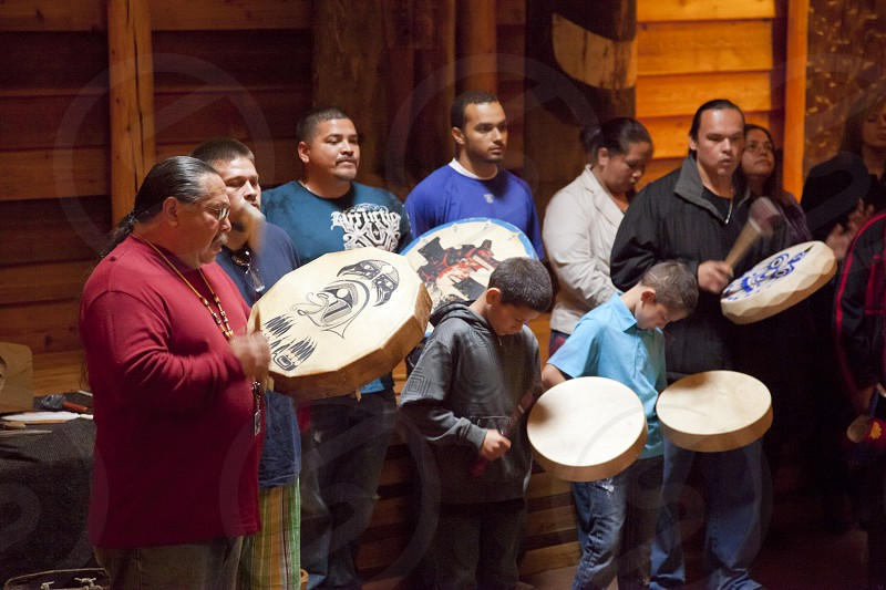 Tulalip Tribe drummers and singers welcome visitors in their new longhouse located at the Hibulb Cultural Center and Museum with traditional songs of the Coast Salish. Marysville  WA. photo