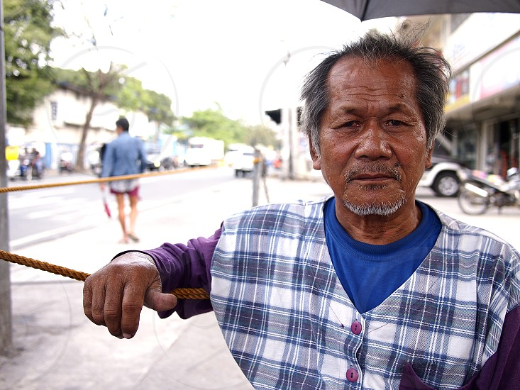 ANTIPOLO CITY PHILIPPINES - NOVEMBER 30 2018: An Asian man rests poses and smiles for the camera. photo