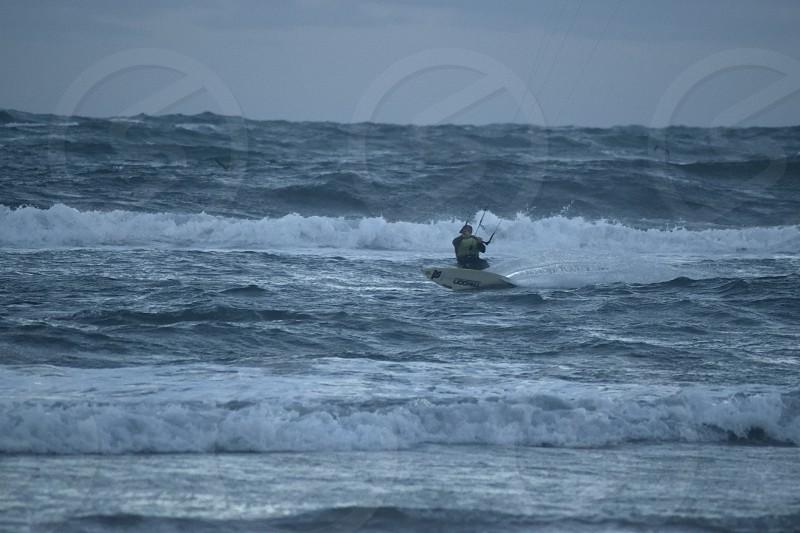 Kite surfers on Gamboa Beach in Peniche Portugal photo