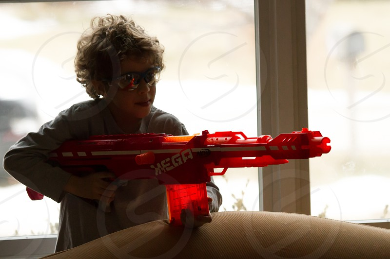 Boy playing with nerf gun photo