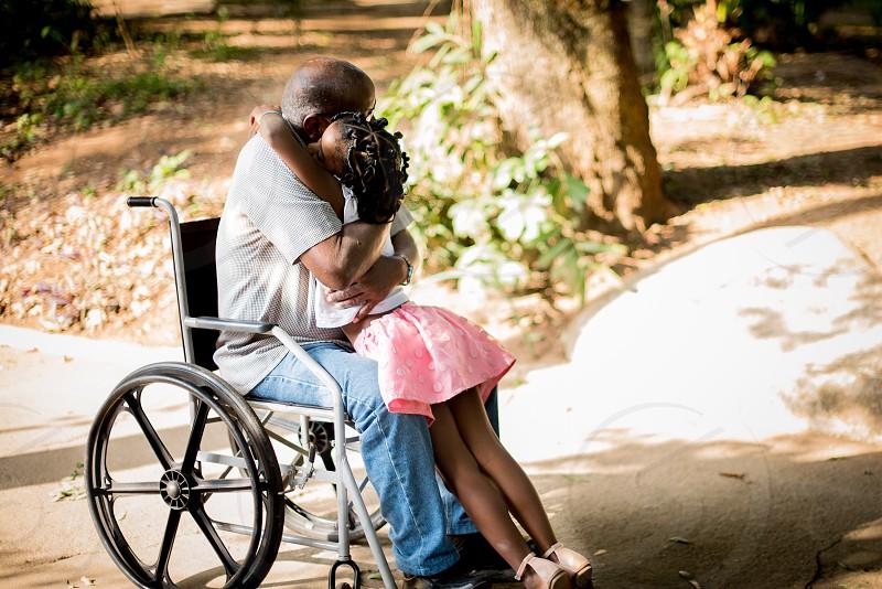 Grandpa and granddaughter big hug! photo