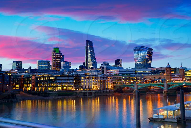 London skyline sunset on Thames river reflection at UK photo