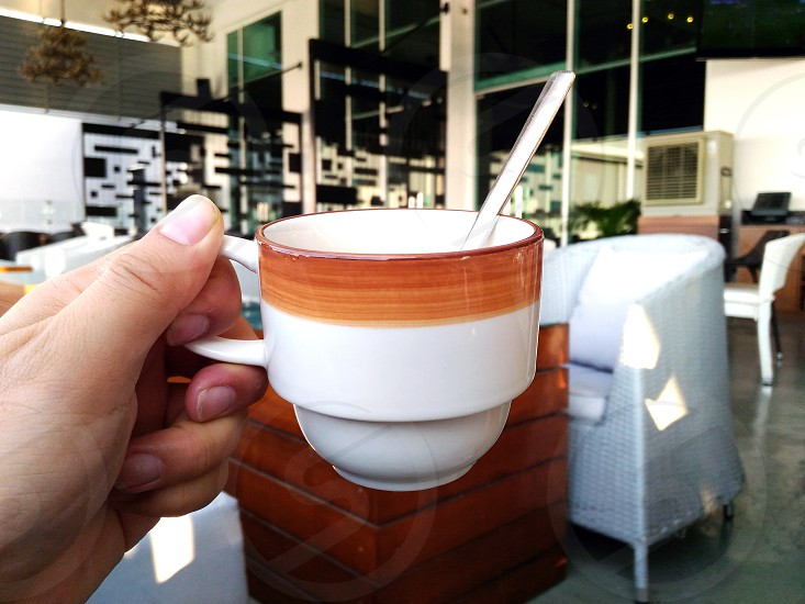 white and brown ceramic mug photo