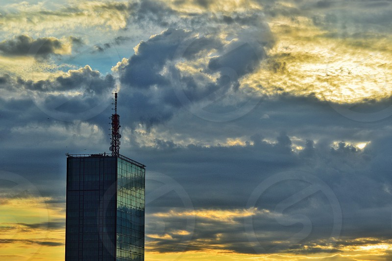 Cloudy sunset sky over business tower Belgrade Serbia photo