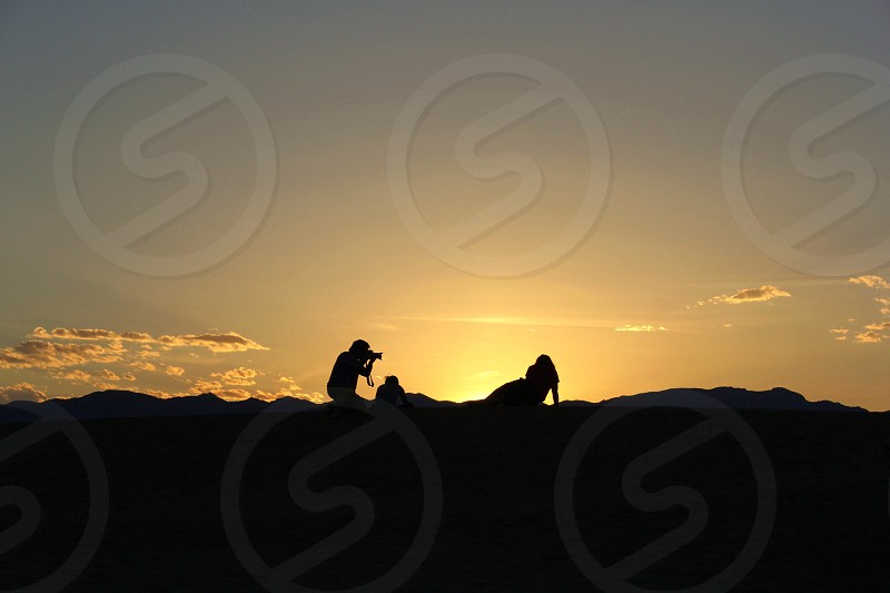 people on mountain silhouette photo
