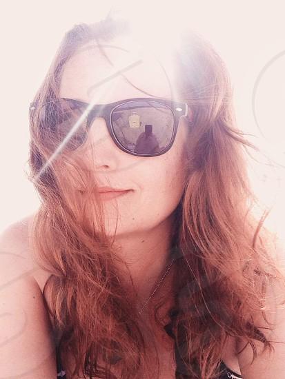 woman wearing black wayfarer sunglasses photo