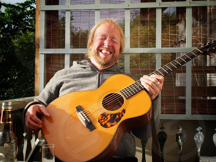 It's fun to play the guitar... Laughing happy middle aged man Sweden photo