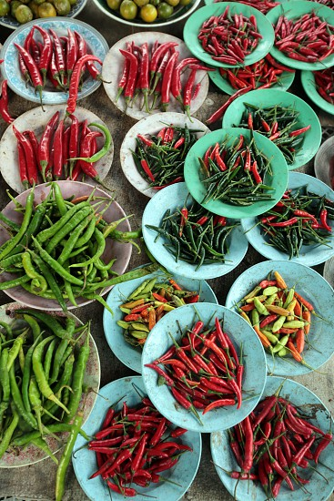 asia brunei food asia food spices ingredients market borneo chil hot spicy red chili green chili protion plate cocking photo