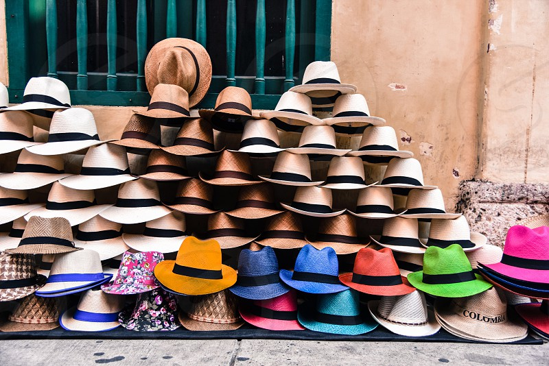 Colorful hats everywhere in the streets of Cartagena Colombia photo