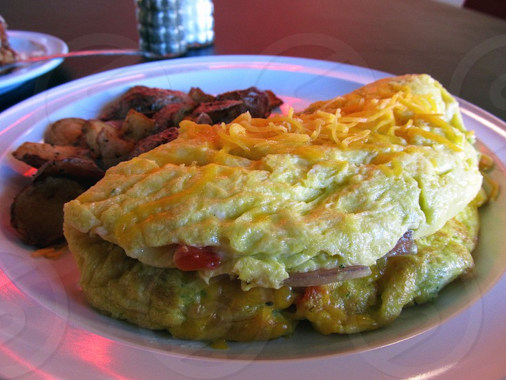 Fluffy omelet and home fries photo