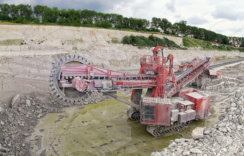 Bucket-wheel excavator in a chalk open pit mine. panorama made of 4 separate images. photo