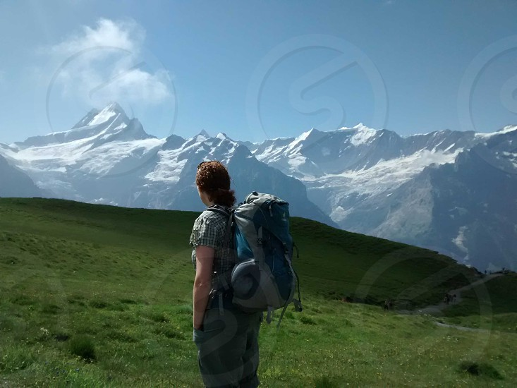 woman hiking in the Alpine mountains photo