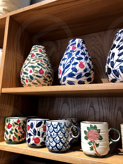 cups toys plates jugs and other ceramic goods. photo