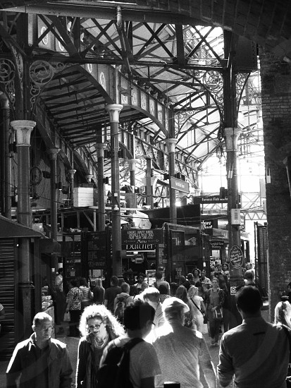 A busy market in London food market crowd people black and white photo