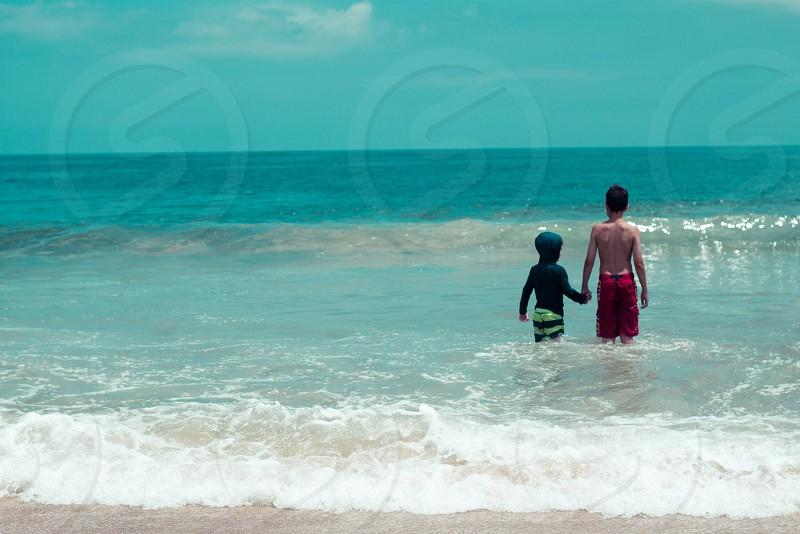 boys friends ocean beach photo