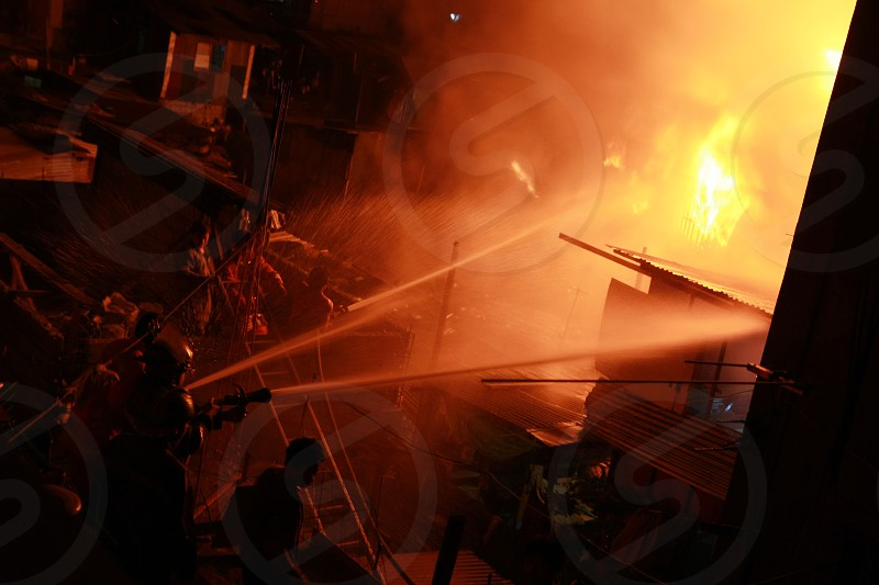 fireman fighting the fire photo