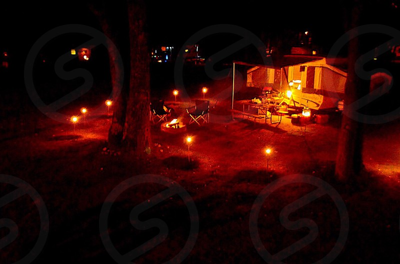 Camping romantic night shot elevated northern Michigan tiki torches lifestyle state of mind.  photo