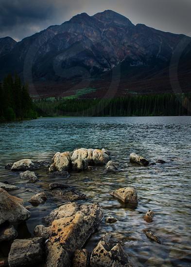 Lake rocks reflection national park Jasper Alberta mountains trees water photo