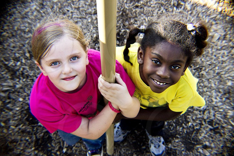 best friends girls playground bright eyes looking up companionship photo