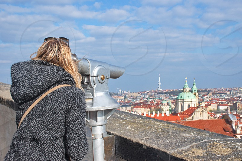 Woman looking at cityscape of Prague photo