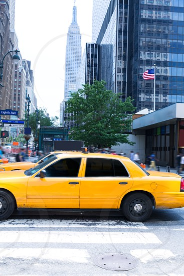 Manhattan 8th Av New York city yellow taxi cab downtown NYC US photo