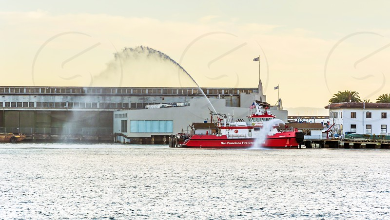 Fireboat spraying water photo