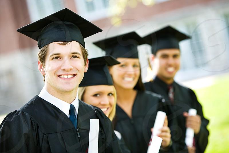 Multi-ethnic group of college graduates. photo