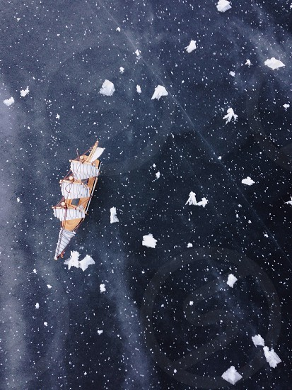 miniature of a galleon on top of a black textile photo