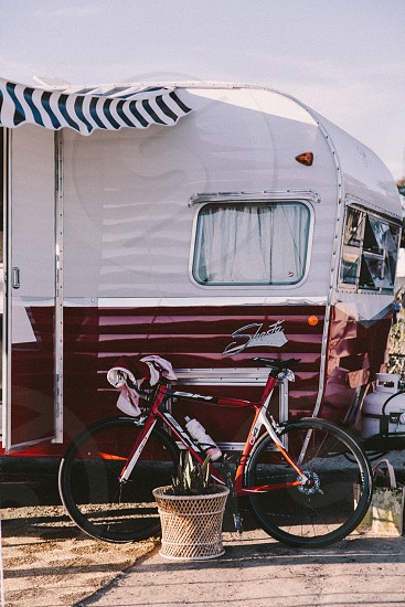 red bicycle next to red and white trailer photo